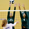 WARREN DILLAWAY / Star Beacon<br /> AALIYAH HUNT (4) and Sharisse Hunt (23), both of Lakeside, leap for a block of a spike by Alicia Major of Madison on Tuesday night at Lakeside.