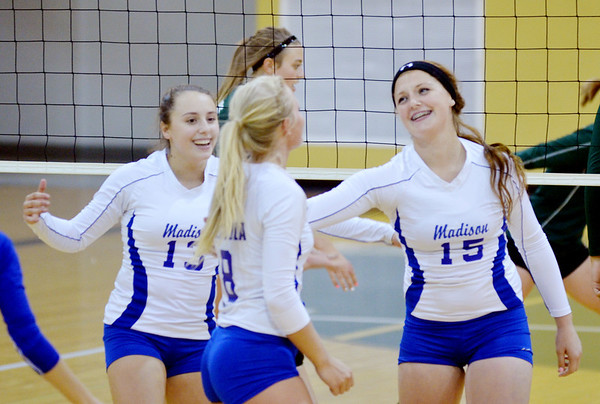 WARREN DILLAWAY / Star Beacon<br /> ALICIA MAJOR  (15) and Madison teammates Jess McPeck (13) and Caila Denicola on Tuesday evening during a match at Madison.