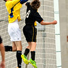 WARREN DILLAWAY / Star Beacon<br /> MATT LUNGHOFER (left), Lakeside goalie, leaps for the ball with Colton Priester of Riverside on Tuesday at Lakeside.