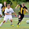 WARREN DILLAWAY / Star Beacon<br /> FLORENT KOLOLLI (20) of Lakeside and Matt Cimperman (13) of Riverside race for the ball on Tuesday during a match at Lakeside.