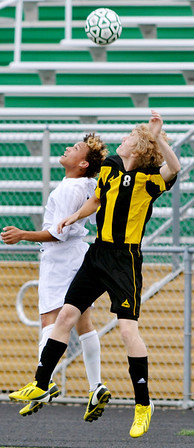 WARREN DILLAWAY / Star Beacon<br /> TREY-VOUGHN HENTON (left) of Lakeside and Chris Niess of  Riverside leap to head the ball on Tuesday during a soccer match at Lakeside.