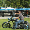 WARREN DILLAWAY / Star Beacon<br /> JIM BUBY of Geneva is one of thousands of motorcyclists who will spend the weekend at Thunder on the Strip at Geneva-on-the-Lake.  Workers were already setting up an entertainment stage for weekend bands.