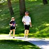 WARREN DILLAWAY / Star Beacon<br /> CLYDE AND Ann Laughlin work out in Conneaut Township Park on Thursday morning.