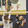 WARREN DILLAWAY / Star Beacon<br /> MEGAN TESSMER (3) of Conneaut leaps for a block of a spike by Emily DeGeorge (10) of Jefferson on Thursday night  at Garcia  Gymnasium in Conneaut.