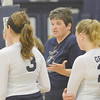 WARREN DILLAWAY / Star Beacon<br /> MO RITARI (facing), Conneaut volleyball coach, talks to her team during a time out on Thursday during a home match with Jefferson.