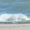 WARREN DILLAWAY / Star Beacon<br /> WAVES CRASH on Conneaut Township Park beach on Thursday morning as a walker get some exercise on a beautiful late summer day.