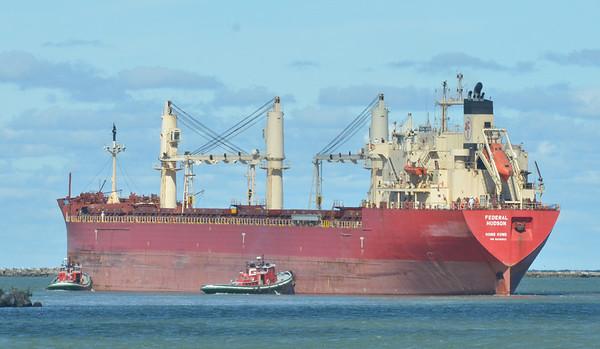 WARREN DILLAWAY / Star Beacon<br /> TUG BOATS help the Federal Hudson navigate Ashtabula Harbor on Thursday.