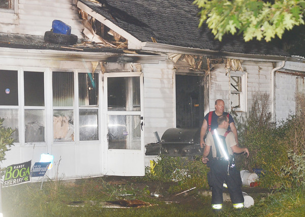 WARREN DILLAWAY / Star Beacon<br /> FIREFIGHTERS FROM four area departments battled a blaze at 5070 Furnace Road in Monroe Township on Thursday evening.