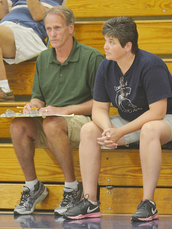 WARREN DILLAWAY / Star Beacon<br /> MO RITARI (right), Conneaut volleyball coach, and Tom Ritari, an assistant, watch the action on Thursday during a home match with Jefferson.