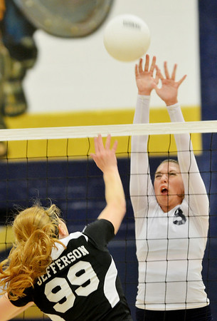 WARREN DILLAWAY / Star Beacon<br /> MEGAN TESSMER (3) of Conneaut leaps for a block of a spike by Hayley Allen of Jefferson on Thursday night  at Garcia  Gymnasium in Conneaut.