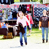WARREN DILLAWAY / Star Beacon<br /> BRENDA AND Randy Leymarie, of Milton, Pa., check out the vendors' area during Thunder on the Strip at Genevav-on-the-Lake on Friday afternoon.