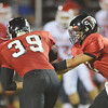 WARREN DILLAWAY / Star Beacon<br /> COLE ERDEL of Jefferson (right) hands the ball to Ryan Zindash on Friday night during a home game with Edgewood.