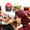 WARREN DILLAWAY / Star Beacon<br /> TRAVIS KISER, Pymatuning Valley quarterback, tries to find running room on Friday night during a home game with Cardinal.