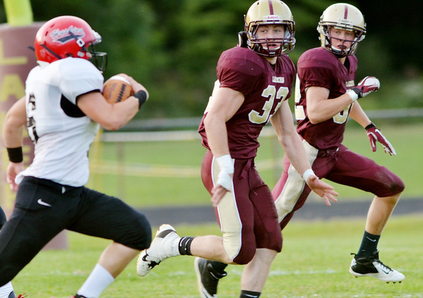 WARREN DILLAWAY / Star Beacon<br /> NICK SUCH (33) of Pymatuning Valley and Laker teammate Nick HOlt (right) chase Cody Purpura of Cardinal on Friday night in Andover Township.