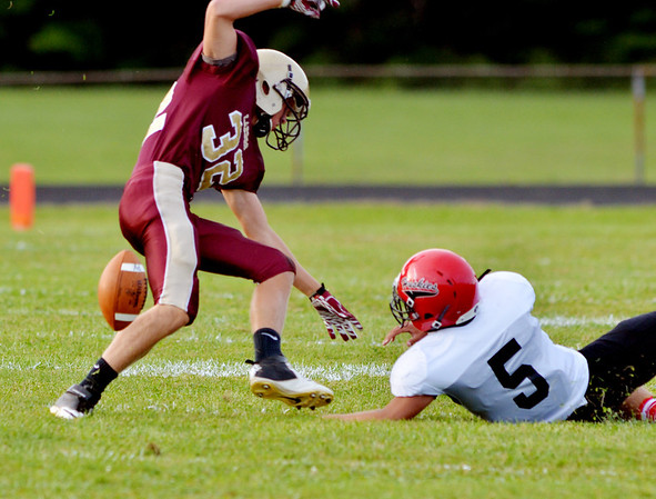 WARREN DILLAWAY / Star Beacon<br /> NICK HOLT (32) of Pymatuning Valley loses the ball as Jutin McClain (5) of Cardinal reaches for the ball on Friday  night at Jefferson..