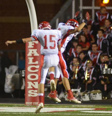 WARREN DILLAWAY / Star Beacon<br /> ALEX WISNYAI (15) and Connor McGlaghlin, both of Edgewood, celebrate after a touchdown on Friday night at Jefferson. The play was called back due to a penalty.