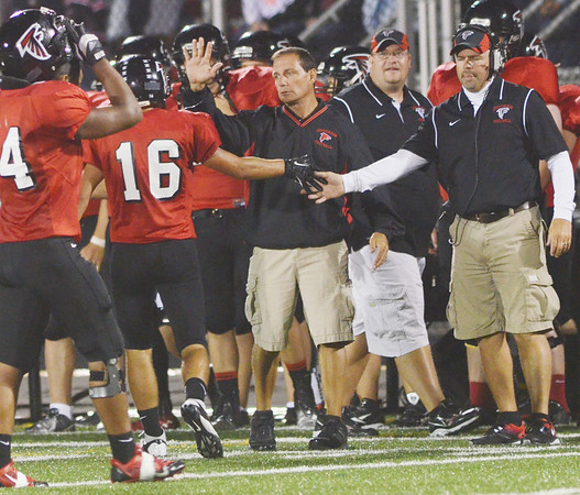 WARREN DILLAWAY / Star Beacon<br /> MEMBERS OF  the Jefferson coaching staff celebrate with Joe Baitt (16) after a big play during a home ggame with Edgewood on Friday night.