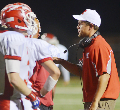 WARREN DILLAWAY / Star Beacon<br /> JOSH FRANKE, Edgewood football coach, addresses his players during a break in the action on Friday night during a game at Jefferson.