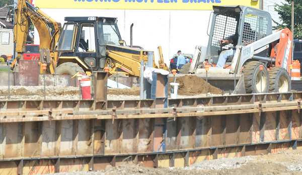WARREN DILLAWAY / Star Beacon<br /> THE FOUNDATION of a new auto parts store is taking shape at the intersection of Route 20 and West Avenue in Ashtabula.