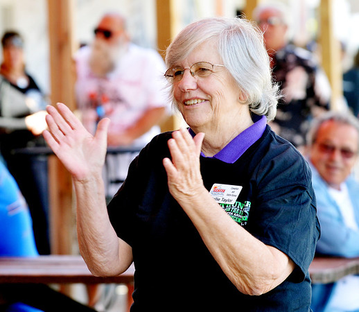 WARREN DILLAWAY / Star Beaon<br /> MARGE MILLIGAN, president of the Geneva-on-the-Lake Chamber of Commerce, claps to the beat of the Lost Sheep Band on Friday afternoon during the Thunder on the Strip at GOTL>