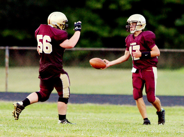 WARREN DILLAWAY / Star Beacon<br /> TRAVIS KISER (17) receives congratulations from Pymatuning Valley teammate Hutner Rhoades on friday night after Kiser scored a touchdown during a home game with Cardinal.