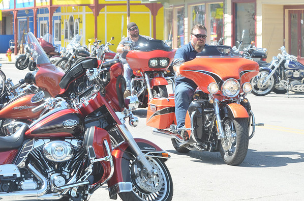 WARREN DILLAWAY / Star Beacon<br /> MOTORCYCISTS PARK along the strip for Thunder on the Strip in Geneva-on-the-Lake this weekend.