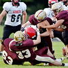WARREN DILLAWAY / Star Beacon<br /> PYMATUNING VALLEY defenders Shawn Shreves (63), Nick Such (33), Nicholas Blascak (5) and Nick Holt (far right) surround a Cardinal ball carrier on Friday night in Andover Township.
