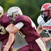 WARREN DILLAWAY / Star Beacon<br /> J.T. WILLIS (with ball) and Pymatuning Valley blocker Shawn Shreves (63) try to get around the corner as Logan Schultz of Cardinal is in hot pursuit on Friday night in Andover Townhip.