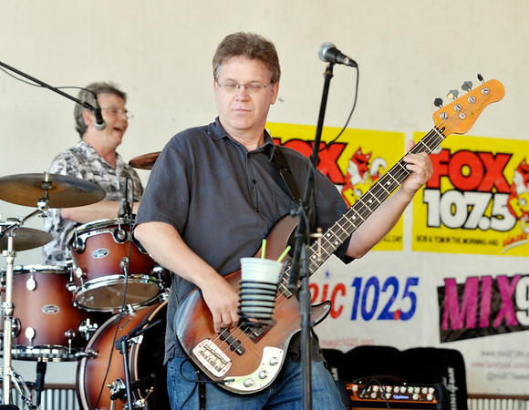 WARREN DILLAWAY / Star Beacon<br /> JIM ALES makes music with the Lost Sheep Band on Friday afternoon during Thunder on the Strip at Geneeva-on-the-Lake.