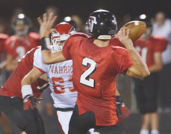 WARREN DILLAWAY / Star Beacon<br /> JAYSON GREENWOOD (63) of Edgewood rushes Cole Erdel, Jefferson quarterback on Friday night at Jefferson.
