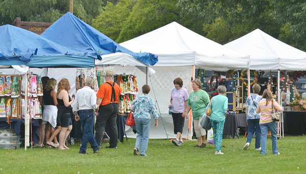 WARREN DILLAWAY / Star Beacon<br /> HUNDREDS OF people attended Crafts on the Lake at Lake Shore Park on Saturday. The event continues this morning and is open till 5 p.m. with more than 90 vendors. The event is free of charge.
