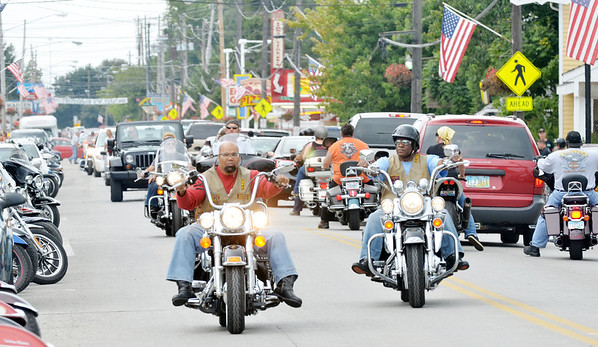 WARREN DILLAWAY / Star Beacon<br /> MOTORCYLES RIDE the strip at Geneva-on-the-Lake during Thunder on the Strip Bike Rally on Saturday.