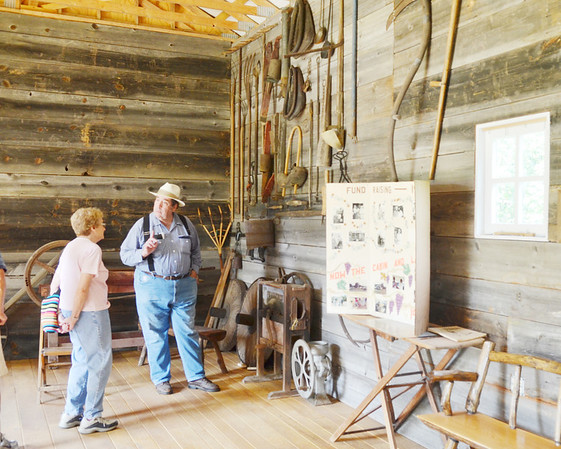 WARREN DILLAWAY / Star Beacon<br /> DAVE MARTIN greets visitors to the recently completed barn at Blakeslee Log Cabin in Plymouth Township on Saturday during Log Cabin Days.
