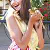 DEVASTASHA BEAVER / Star Beacon<br /> EMILY GRUBER, 17, Austinburg Country Maiden, prepares to kiss a frog during the final day of Austinburg Country Days  on Sunday afternoon.