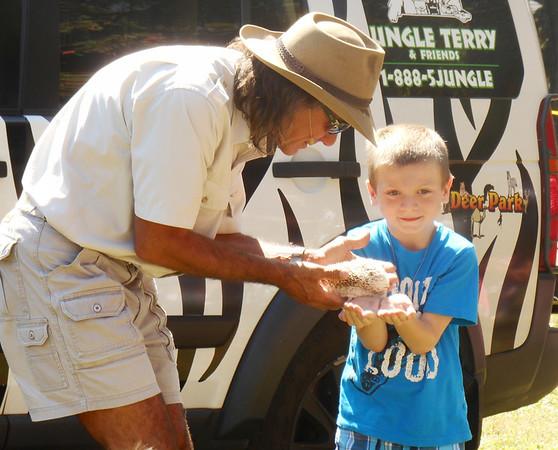 DEVASTASHA BEAVER / Star Beacon<br /> JUNGLE TERRY shows a hedgehog to a child at Austinburg Country Days on Sunday in Austinburg Township.