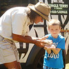 DEVASTASHA BEAVER / Star Beacon<br /> JUNGLE TERRY shows a hedgehog to a child at Austinburg Country Days on Sunday in Austinburg Township.