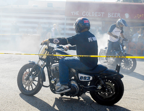 DEVASTASHA BEAVER / Star Beacon<br /> STUNT RIDERS demonstrate their motorcycle riding skills on Sunday during the final day of Thunder on the Strip Bike Rally at Geneva-on-the-Lake.