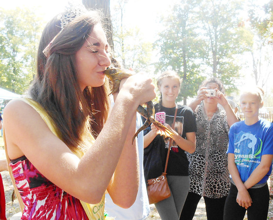 DEVASTASHA BEAVER / Star Beacon<br /> EMILY GRUBER, 17, Austinburg Country Maiden, kisses a frog during the final day of Austinburg Country Days  on Sunday afternoon.