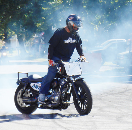 DEVASTASHA BEAVER / Star Beacon<br /> A STUNT rider demonstrates his motorcycle riding skills on Sunday during the final day of Thunder on the Strip Bike Rally at Geneva-on-the-Lake.