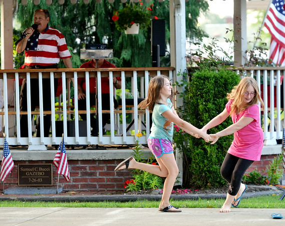 WARREN DILLAWAY / Star Beacon<br /> JOSILYN BISBEE (right), 10, and Kiersten Bisbee, 8, both of Ashtabula Township dance up a storm during the Summer Concert Series at Peleg Park in Ashtabula Township.