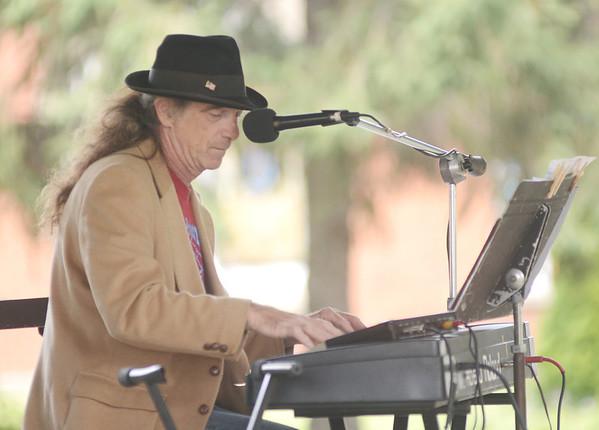 JIM FULLER performs at the Brown Bag Concert Series at Cornelius Park in Ashtabula.