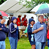 WARREN DILLAWAY / Star Beacon<br /> MUSIC FANS try to stay dry at the Conneaut Dockfest on Saturday afternoon.