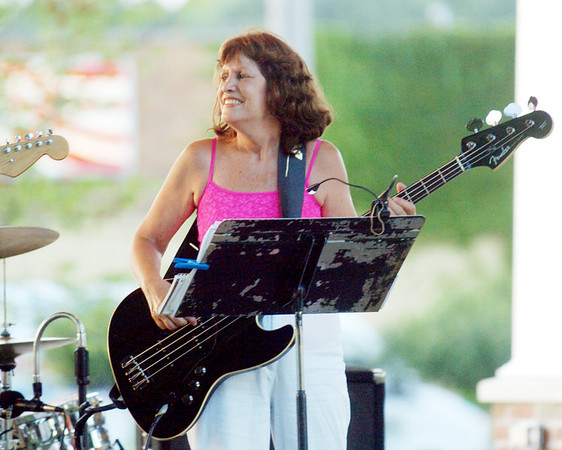 LINDA DANA is all smiles while playing in downtown Geneva.