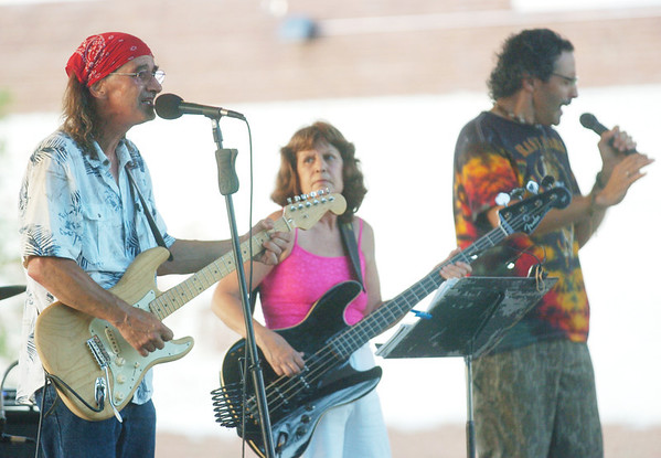 ED DANA (far left), Linda Dana and Rick Mollick belt out a tune during a concert at the Gazebo in downtown Geneva.