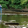 WARREN DILLAWAY / Star Beacon<br /> IAN KAFERLE of Saline, Mich., fishes with his grandmother Nancy Kaferle of Geneva Tuesday on the Grand River near the Harpersfield Covered Bridge.