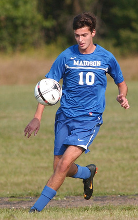 WARREN DILLAWAY / Star Beacon<br /> CONNOR BALL of Madison controls the ball Tuesday during a game at Edgewood.