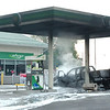 WARREN DILLAWAY / Star Beacon<br /> FIREFIGHTERS APPLY foam to a vehicle after a two vehicle collision at the intersection of Route 45 and Route 6 in New Lyme continued into the BP Station where two more vehicles were struck and a gas pump destroyed late Tuesday afternoon.