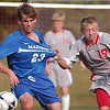 WARREN DILLAWAY / Star Beacon<br /> DAVID FEDOR (23) of Madison and Edgewood's Breyton Santee fight for the ball Tuesday at Edgewood.