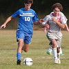 WARREN DILLAWAY / Star Beacon<br /> CONNOR BALL of Madison and Marco Orlando of Edgewood chase the ball Tuesday during a match at Edgewood.