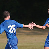 WARREN DILLAWAY / Star Beacon<br /> CONNOR BALL (10) and Brandon Terleman (25) celebrate after a Madison goal Tuesday at Edgewood.